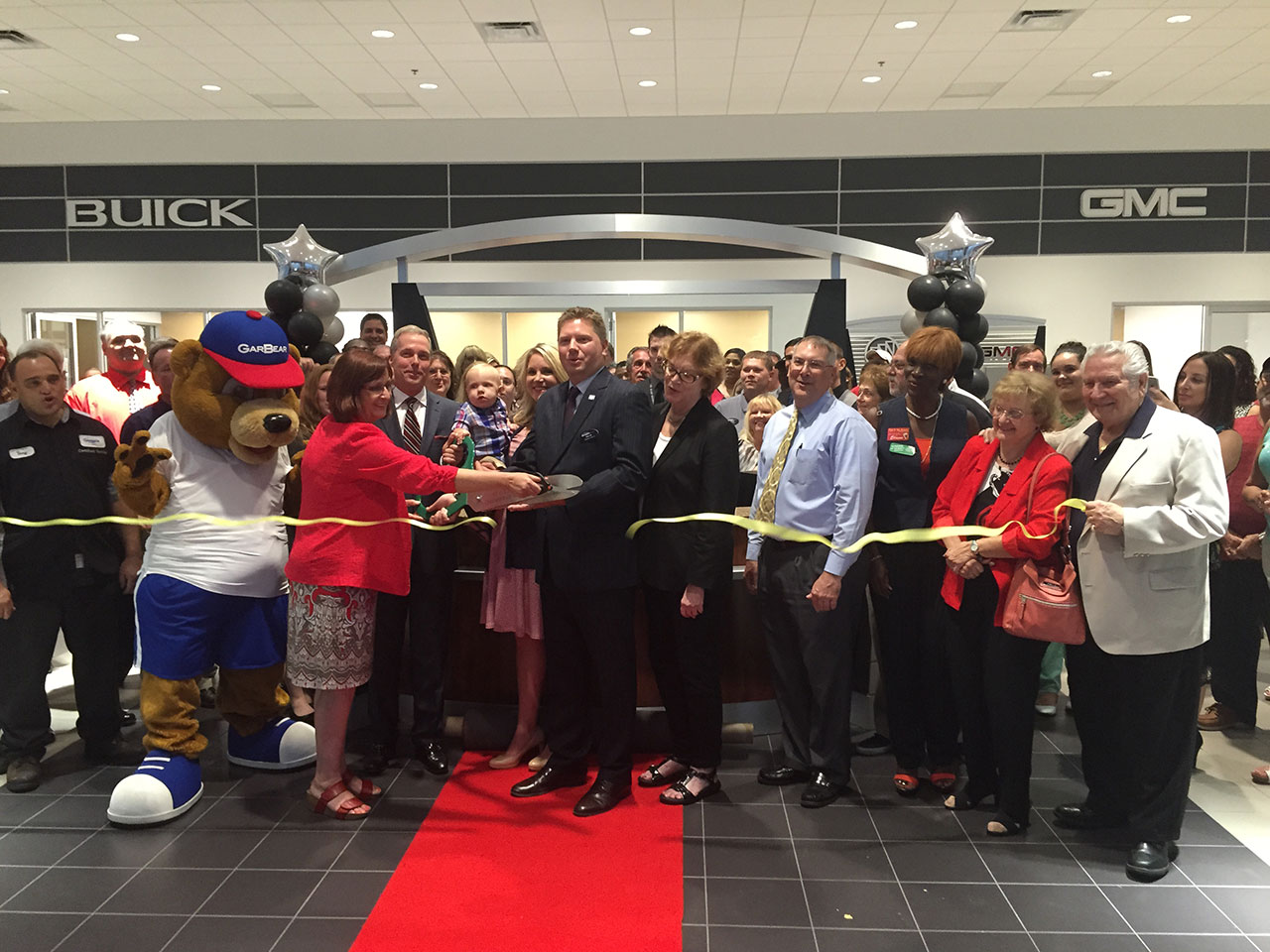 Richard J. Garber Jr. and General Manager Michael Weinert cut the ribbon for the new dealership.