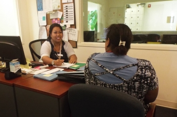 Shelter coordinator meets with a potential resident to discuss the possibility of her living in Compassion House.