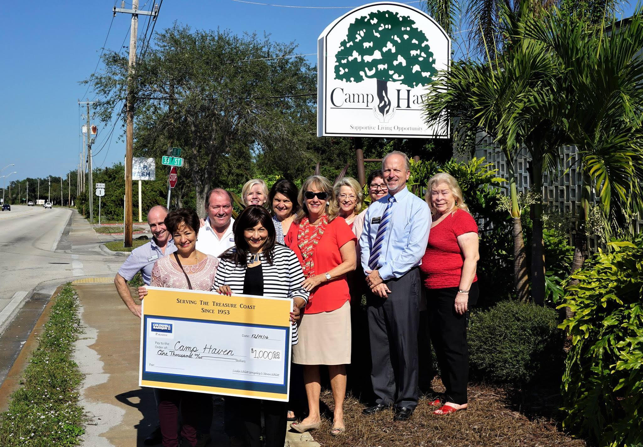 Coldwell Banker Paradise presents donation to Lalita Janke, Camp Haven Interim Executive Director.