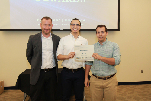 Dr. Kevin Cooper, IRSC Dean of Advanced Technology, congratulated Gabe DeAvila and Daniel DeAvila, winners of the College's Entrepreneurial & Innovation Challenge for creating a new company designing lab equipment with a 3D printer.