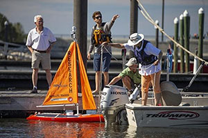 A Harbor Branch Oceanographic Institute autonomous research sailboat is placed on Lake Okeechobee