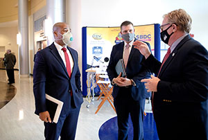 Tom Kindred, right, and Andrew Treadwell, center, of IRSC